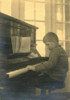 6-year-old Tadeusz Baird at the piano